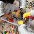 Children cleaning their legos/spacecraft parts