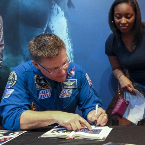 Astronaut Doug Wheeler signs autographs at Astronomy Days 2018.
