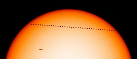 Mercury transits the Sun in 2003, as seen by the SOHO spacecraft.