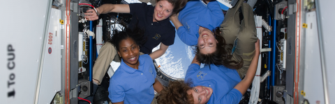 Image: From lower right clockwise, NASA astronauts Dorothy Metcalf-Lindenburger, Stephanie Wilson, Tracy Caldwell Dyson, and Naoko Yamazaki pose for group photo in the Cupola of the International Space Station (STS-131). (National Archives Catalog/NASA)