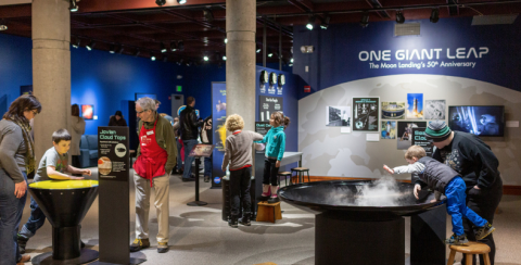 Visitors interacting with Destination Space! exhibit